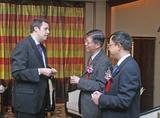 美国艾斯本技术公司亚太市场总监(左),上海复旦大学副校长(中)